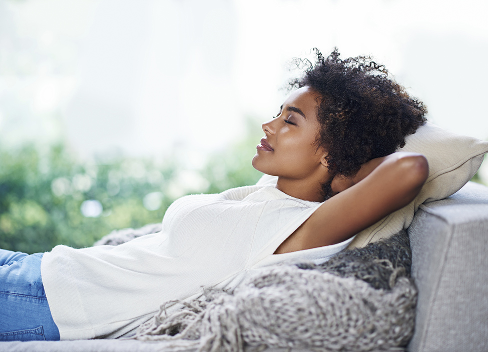 woman de-stress on couch