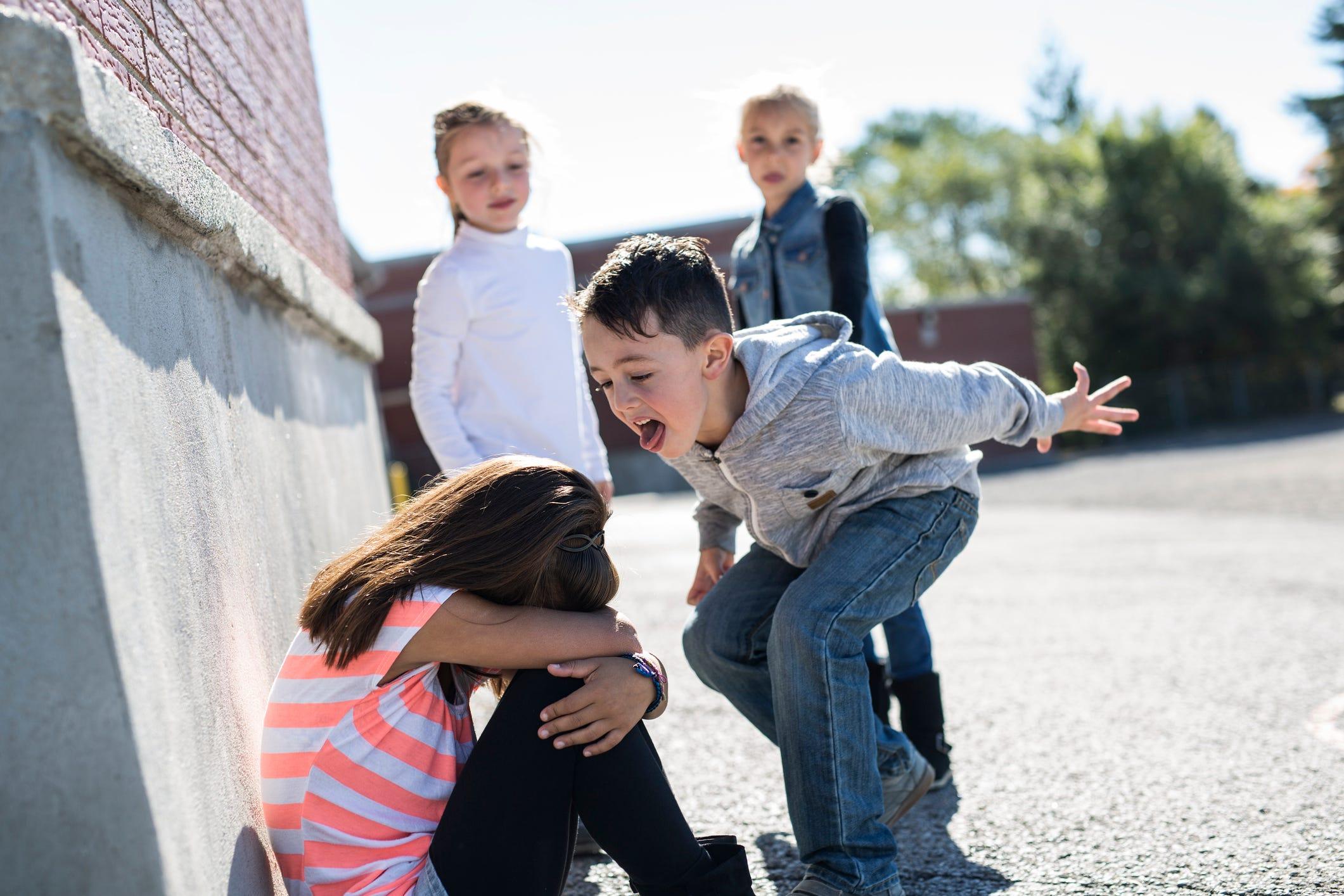 Children Bullying A Little Girl